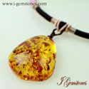 Tetrahedral Natural Amber Pendant Knotted With Silk Cord